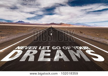 Never Let Go Of Your Dreams written on desert road