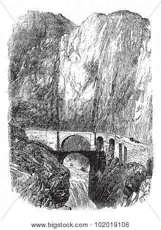Devil's Bridge in Uri, Switzerland, during the 1890s, vintage engraving. Old engraved illustration of the Devil's Bridge. Trousset Encyclopedia