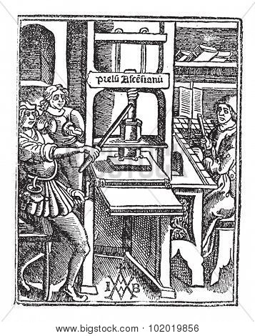 Screw press, vintage engraving. Old engraved illustration of Screw press with three workers working on it. Trousset encyclopedia (1886 - 1891)