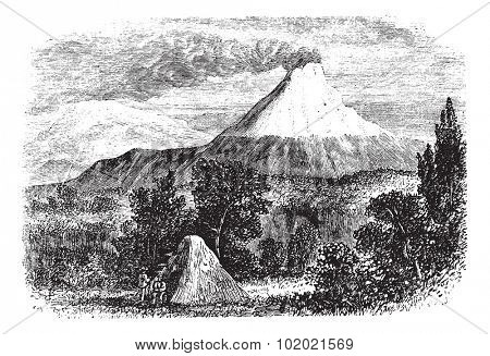 Cotopaxi Volcano in Equador, during the 1890s, vintage engraving. Old engraved illustration of Cotopaxi Volcano. Trousset encyclopedia (1886 - 1891).