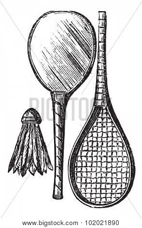 Two Rackets and shuttlecock, vintage engraving. Old engraved illustration of Two Rackets and shuttlecock isolated on a white background. Trousset encyclopedia (1886 - 1891).