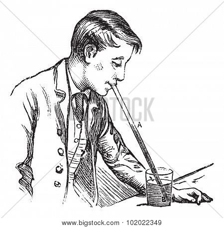 Atmospheric pressure on a liquid, vintage engraving. Old engraved illustration of Atmospheric pressure on a liquid by man. Trousset encyclopedia (1886 - 1891).