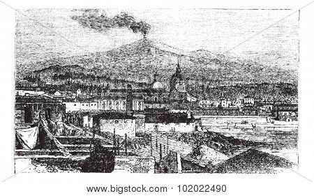 Mount Etna in Sicily, Italy, during the 1890s, vintage engraving. Old engraved illustration of Mount Etna as viewed from Catania City. Trousset encyclopedia (1886 - 1891).