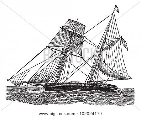 Schooner, vintage engraved illustration. Schooner sailboat at sea. Trousset encyclopedia (1886 - 1891).