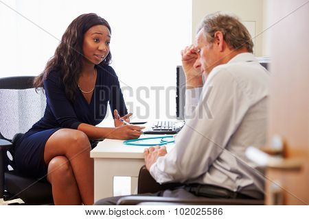 Female Doctor Treating Patient Suffering With Depression