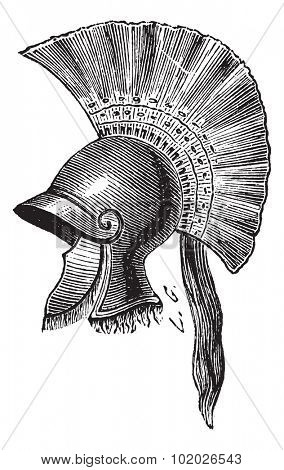Old engraved illustration of Greek helmet criniere de cheval isolated on a white background. Industrial encyclopedia E.-O. Lami 1875.