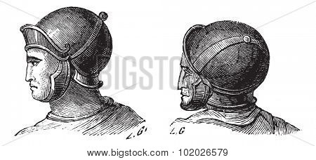 Old engraved illustration of legionary helmets isolated on a white background. Industrial encyclopedia E.-O. Lami 1875.