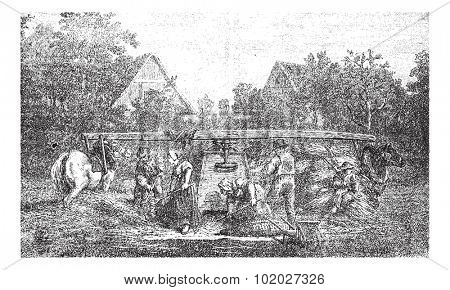 Old engraved illustration of five people making stock ready for threshing machine in the field. Industrial encyclopedia E.-O. Lami - 1875.