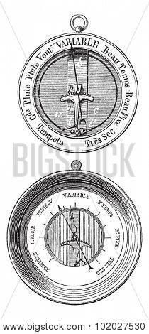 Old engraved illustration of Two Bourdon barometers isolated on a white background. Industrial encyclopedia E.-O. Lami - 1875.