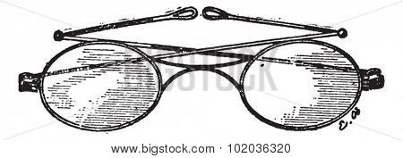 Glasses, k bridge, vintage engraved illustration. Dictionary of words and things - Larive and Fleury - 1895.