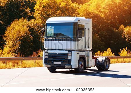 truck is driving on the country highway