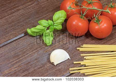 Tomato, Garlic Cloves, Pasta And Basil Leaves