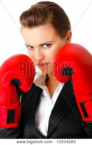 furious modern business woman with boxing gloves