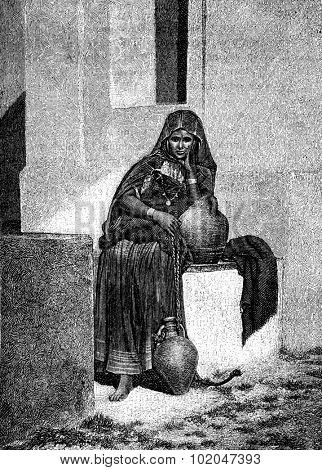 In Tunis. A water carrier, vintage engraved illustration. Journal des Voyages, Travel Journal, (1879-80).