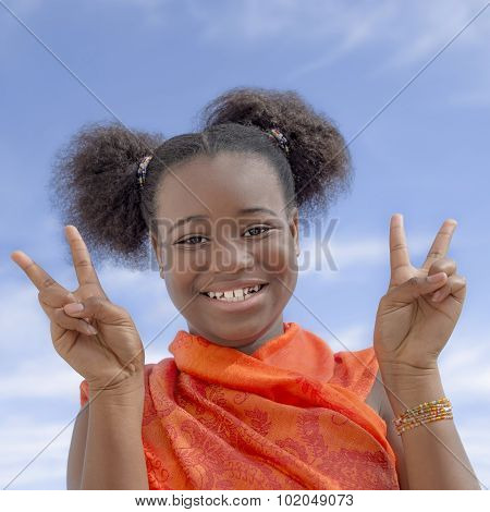 Afro girl with pigtails showing the victory sign