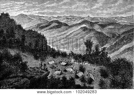 View and camp at night, on the road to Ban Muang Yang Con Ham, vintage engraved illustration. Le Tour du Monde, Travel Journal, (1872).