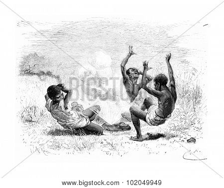 A Bullet Explodes on Three Natives in Angola, Southern Africa, drawing by Bayard based on a sketch by Serpa Pinto, vintage engraved illustration. Le Tour du Monde, Travel Journal, 1881
