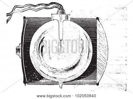 Electric tealight, vintage engraved illustration. Usual Medicine Dictionary - Paul Labarthe - 1885.