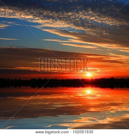 Nice emerald sunset over lake
