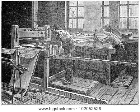 Printing table to the board, vintage engraved illustration. Industrial encyclopedia E.-O. Lami - 1875.