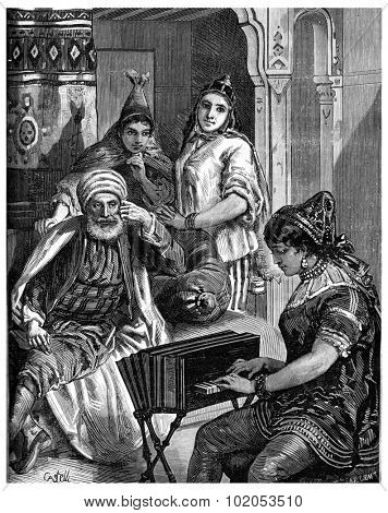 Saturday night in a Jewish family in Tunis, vintage engraved illustration. Journal des Voyage, Travel Journal, (1880-81).