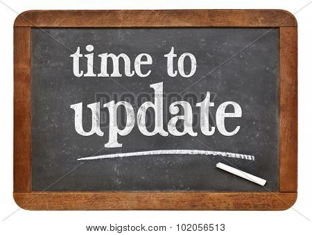 Time to update reminder - white chalk text on a vintage slate blackboard
