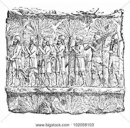 Prisoners (palace of Sardanapalus, Louvre.), vintage engraved illustration