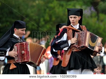 Musicians With The Traditional Costume Of Sardinia.