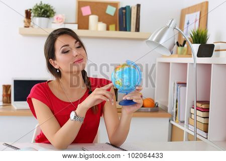 Young Beautiful Female Student Pointing Something On Globe
