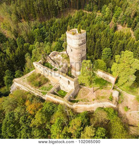 Aerial view of medieval castle Gutstejn over Hadovka brook nearby Pilsen. Autumn landscape in Czech Republic. Central Europe.