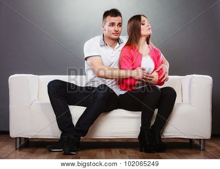Husband Hugging Unhappy Wife. Offended Woman.