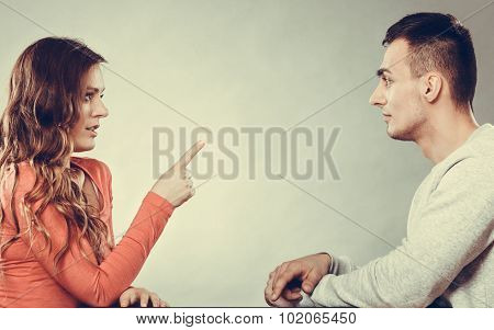 Woman Warning Man. Girl Threatening With Finger.