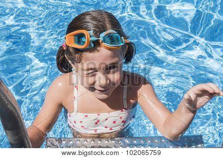 Smiling Girl Enjoying The Pool In Summer