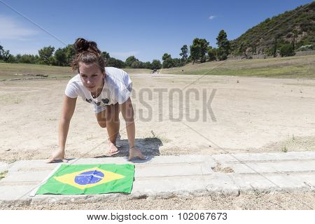 Girl Ready To Run With The Brazilian Flag For The Next Olympics At Olympia, Birthplace Of The Olympi