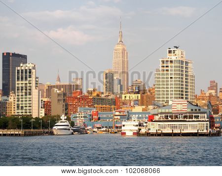 NEW YORK,USA - AUGUST 16,2015 : The docks at the Hudson river with the Empire State Building on the background
