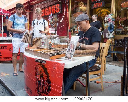 NEW YORK,USA - AUGUST 14,2015 : Man preparing handmade cigars at Mulberry Street in Little Italy, New York City
