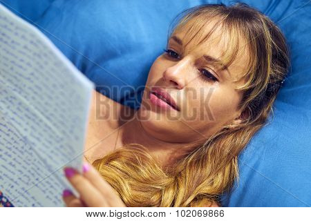 Girl In Bed Crying With Love Letter From Boyfriend