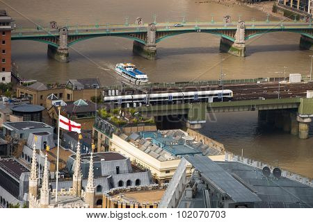 LONDON, UK - SEPTEMBER 17, 2015: Flag of England on the cathedral tower,  with River Thames and Lond