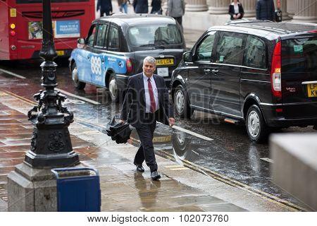 LONDON, UK - SEPTEMBER 17, 2015: Businessmen and businesswoman walking on the street against of Bank