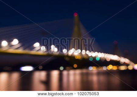 View Of The Bridge Rio-antirio In Greece, At Night. Bokeh Background