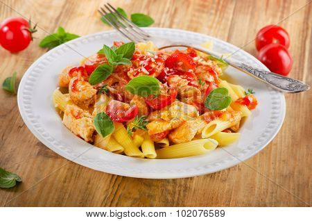 Pasta Penne With Chicken, Tomato Sauce And Vegetables.