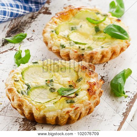 Tart With Cheese On A Wooden Table.