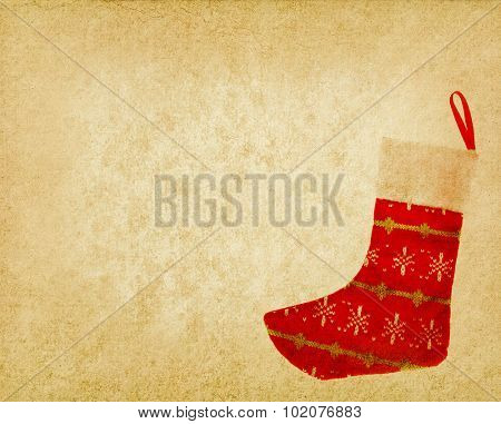 Christmas sock with gifts on wooden background on vintage texture background