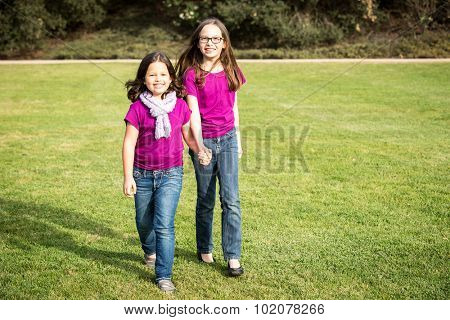 Cute little sister in a park outside