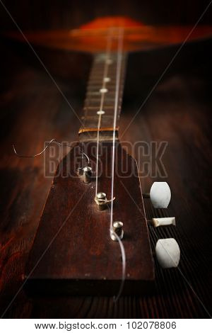 Folk musical instrument balalaika on wooden background