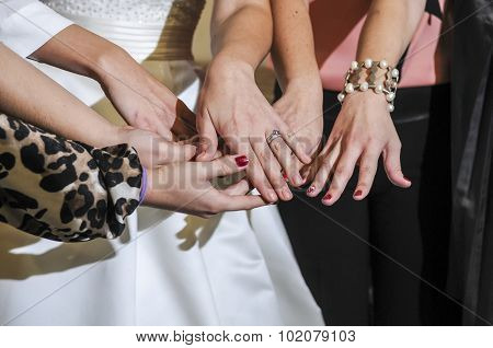 Bride Showing Off The Wedding Ring To Friends