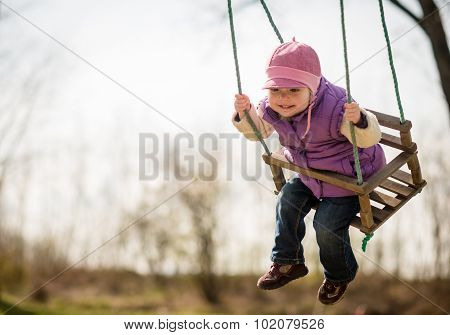 Pure joy - swinging child