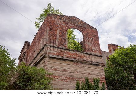 Old window in ruined wall