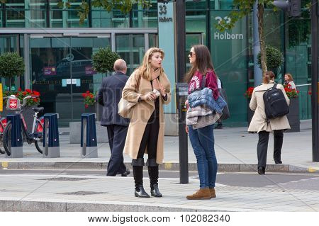 LONDON, UK - SEPTEMBER 19, 2015: Holborn, two young women talking on the street