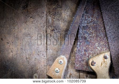 Old Rusty Saw Blades On A Wooden Table
